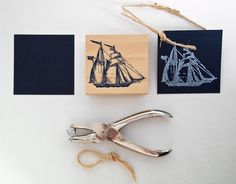 The knotted sisal twine and stamp carved in a barquentine sailboat further communicate our nautical theme