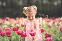 Think spring with this little girl playing in the flower fields at Wicked Tulips in Johnston, Rhode Island photographed by Massart Photography. www.massartphotography.com