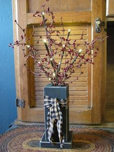 Black Wood Box with Berries and Lights Display simple, primitive style on a dresser or hutch when you add this Black Wood box with berries and lights to your room's decor. Our primitive black painted