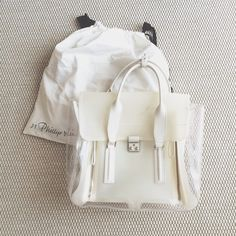 3.1 Phillip Lim Pashli Tote Awesome and unique pashli satchel. Partially transparent/milky off-white, with leather details. Originally purchased from Barney's (tag still attached in pocket). Dustbag included. Light smudging in the front that I haven't tried to deep clean, other than that it's in great shape. Additional pics upon request. If you're on ig I'd be happy dm them! 3.1 Phillip Lim Bags Totes
