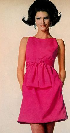 Benedetta is wearing a short fuschia crepe dress sashed high by Gino Charles, photo by Penn, Vogue, 1967