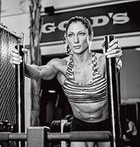 BARBELL HACK SQUAT  Works: Quads   Stand in front of a barbell with your feet hip width and your toes pointed slightly outward.  Squat down and grab the barbell behind you with an overhand grip just o