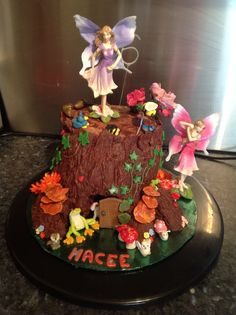 My youngest baby girls cake, loved making this, bark was handmade modelling chocolate.