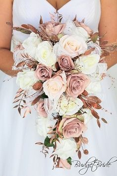 Cascading Rose gold brides bouquet with rose gold pearl accents and lace