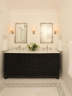 Clean lines of the mirrors and cabinets which make this bathroom looks clean and spacious.