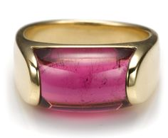 A pink tourmaline and eighteen karat gold ring, Bulgari  centering a saddle style-cut pink tourmaline measuring approximately 12 x 9mm; signed Bulgari; accompanied by signed box