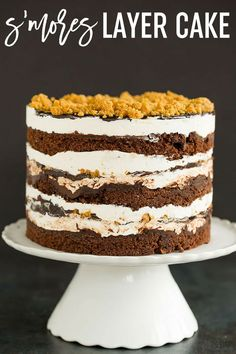 S'MORES LAYER CAKE :: This s'mores cake is built Milk Bar style - layers of chocolate cake, toasted marshmallow frosting, fudge sauce, and graham crust crumbs! via @browneyedbaker
