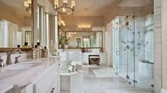 Traditional Master Bathroom with Complex Marble, Handheld showerhead, complex marble tile floors, Steam showerhead