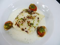 From Oceania Cruises - Seaweed-Flaked Fillet of Atlantic Turbot over Zucchini with Stuffed Clams and Champagne Foam. #oceaniarecipes #cruiselinerecipe