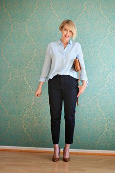 Silk blouse with dark blue pants by NYDJ