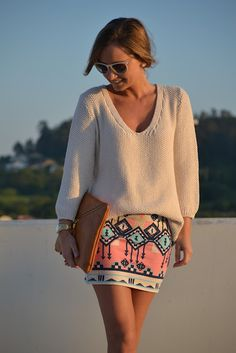 Pink Aztec fitted skirt with oversized knitted (egg shell-white, nude) sweater and oversized clutch