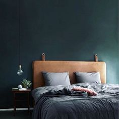 The color of the wall and the texture of the leather headboard by Danish design lab @bythornam is so good.