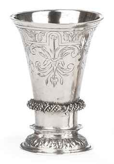 A Dutch silver miniature beaker  Apparently unmarked, possibly Groningen, possibly 17th Century  The flared body on a cast and domed foot below a spiral twist band, the lower body engraved HCR, below engraved foliage  5 cm. high  20 gr.