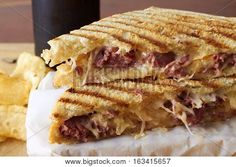 Grilled panini sandwich with meat and cheese