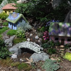 Woodland Village In this quaint little village you will find paths meandering through the woods and across the bridge to get from one cottage to the next. Fairies will enjoy frolicking among the rocks and gardens here.
