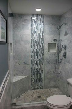 I like the waterfall effect of the tile, only behind the shower head.