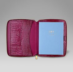 Berry Mara A5 writing folder in printed calf leather is perfect to stow away inside a handbag. http://www.smythson.com/dark-berry-mara-a5-zip-folder.html #ScribeInStyle