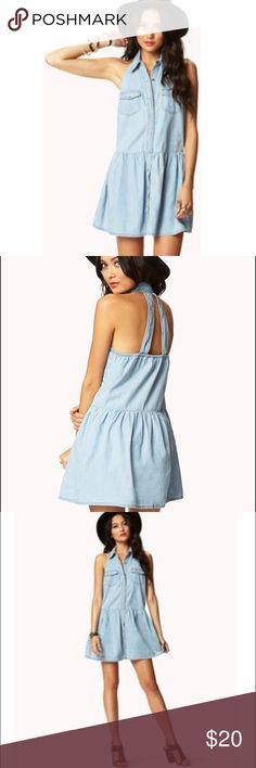 NWT Forever 21 Cut Out Denim Drop Waist Dress NEW with tags- Lightly faded denim chambray dress from Forever 21. Button up with two pockets in front. Ships fast! Forever 21 Dresses Midi
