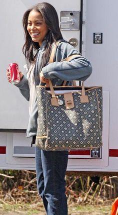 Lauren London on set with her Dooney Crossword tote in hand
