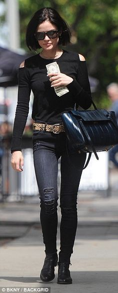 Put together: She finished off her outfit with black ankle booties and a large black handbag slung over her left arm