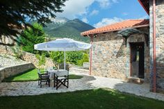 Entire home/flat in Kardaras, Mainalo, Greece. Villa Mainalis is a stylish stone house in an idyllic setting at the slopes of Mainalon Mountain, just away from Athens and less than fro. Summer Winter, Season 1, Athens, Villas, Ski, Greece, Patio, Vacation, Outdoor Decor