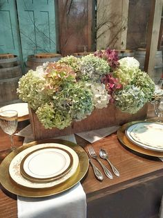 Vintage Thanksgiving in a garage. Complete with farmtables, vintage tool box and fresh hydrangeas and vintage China. By Debrakolrud on Instragram