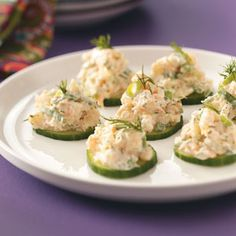 Cucumber Shrimp Appetizer: My easy version would be to just buy shrimp or seafood salad and spoon on top of each slice.  You could also layer the cucumber/shrimp on top of those mini tea sandwich breads. The dill sprigs spruce it up and make it special.