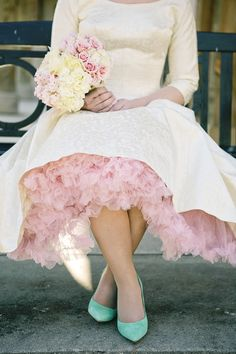 a hint of pink petticoat, photo by Tiffany Hughes http://ruffledblog.com/1950s-inspired-auburn-wedding #weddingdress #vintage #petticoats