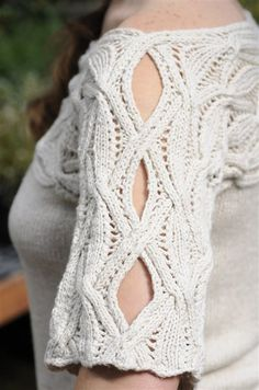 Go There Now MENEMSHA PULLOVER Angela Hahn Cables aren't just for cold weather. This top is summer-ready with an airy cable-and-lace pattern. Pattern travels sideways across the… Knitting Designs, Knitting Stitches, Knitting Yarn, Knitting Projects, Knitting Patterns, Crochet Patterns, Knitting Tutorials, Textiles, Knitting Daily
