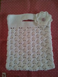 Crochet bag,i would put a strap on it but it is adorable