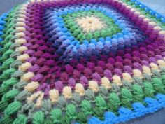 GRANNY SQUARE she calls it a pineapple stitch when its really the Puff stitch. instructions could be more clear but not everybody does