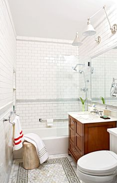 """Almost any bathroom can incorporate a tiled """"rug"""" on the floor. You can add one to an existing bathroom by simply removing tile from the area you want to add the accent, and then putting down the new tiles. #bathroomideas #bathroomremodel #newbathroom #bathroomdecor #bhg Bathroom Tub Shower, Tub Shower Combo, Glass Shower Doors, Shower Niche, Shower Floor, Master Bathroom, Small Bathroom Storage, Bathroom Design Small, Bathroom Layout"""