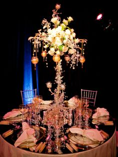 These centerpieces are so pretty! I also love how guests can talk to eachother without having to peek around the centerpiece.