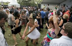 Punters getting their groove on while listening to music at Melbourne Cup day celebrations...