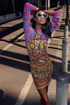 Chanel Iman wears embellished sunglasses and printed dress from Moschino