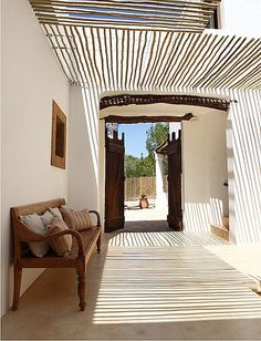 a modern rustic home on Formentera Love the texture and wood pergola/roofing detail House Design, Interior And Exterior, Home, Outdoor Living, Modern Rustic Homes, House Styles, Exterior Design, Mediterranean Decor, Rustic House