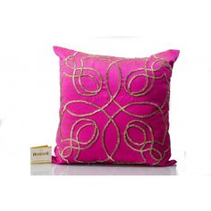 This #Fushia #Silk Cushion Cover with cut dana work in gold color, features back zip; comes with compress poly filler.