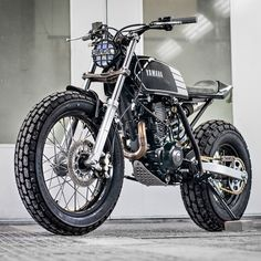 A little bundle of fun from South Africa's Wolf Moto. Who loves this funky, fat-tired Yamaha TW200?