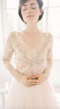 Gorgeous gold bead embroidered long-sleeve wedding dress; Featured Dress: CarouselFashion