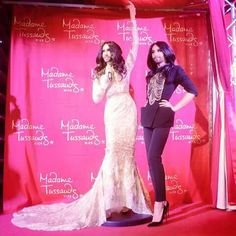 The fabest human that is Conchita with her statue at Madame Tuussauds