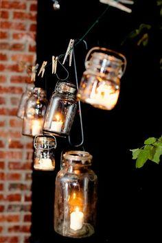 this is a brilliant idea! === mason jars, candles, S hooks, clothes line... brilliant!
