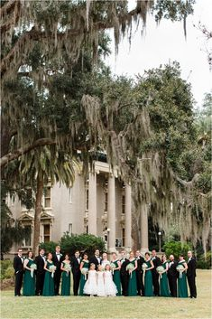 Emerald green bridesmaids dresses, black tuxes, baby's breath bouquets, winter wedding attire, Winter Wedding Party