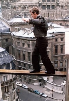 Jean-Paul Belmondo on the set of 'Peur sur la ville', 1974.