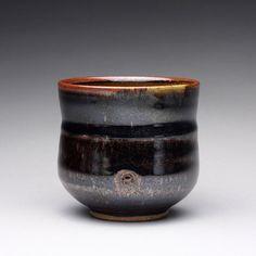 handmade ceramic cup, tea bowl, tumbler with black brown tenmoku and green celadon glazes