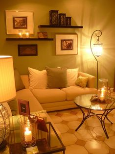 Shelves over couch with pictures. and lamp