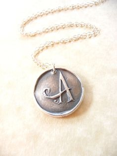Wax seal monogram initial necklace pendant jewelry made from fine silver, custom made to order. $35.00, via Etsy.