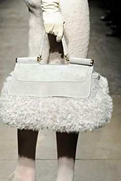 Ok, I love Donna Karan but this looks like she put a handle on a poodle and called it a purse  .