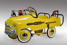 How cute.. back in the day when kids actually peddled their first cars.