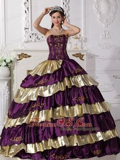 Sweet Purple and Gold Quinceanera Dress Strapless Floor-length Taffeta Embroidery Ball Gown  http://www.fashionos.com  http://www.facebook.com/quinceaneradress.fashionos.us  The exquisite strapless bodice is accented by specific embroidery.The ball gown floor length skirt adorned by the tiers of ruffles and the contrasting color bring this dress dramatic effect.The lace up back completes the look.You will look like a noble pricess on the dress.