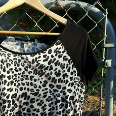 Forever 21 Leopard Top Cute and sassy leopard/cheetah print top with hi-low hem. Soft and semi sheer. Excellent condition. No stains or tears. No trades, holds, or Paypal. Forever 21 Tops